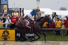 May 16, 2015; Baltimore, MD, USA; Victor Espinoza aboard American Pharoah celebrates winning the 140th Preakness Stakes at Pimlico Race Course. Mandatory Credit: Peter Casey-USA TODAY