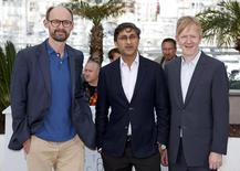 """Director Asif Kapadia (C), producer James Gay-Rees (L)  and video editor Chris King pose during a photocall for the film """"Amy"""" out of competition at the 68th Cannes Film Festival in Cannes, southern France, May 16, 2015.  REUTERS/Eric Gaillard"""