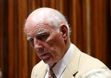 Former Grand Slam doubles champion Bob Hewitt looks on ahead of court proceedings at the  South Gauteng High Court in Johannesburg February 10, 2015.  REUTERS/Siphiwe Sibeko
