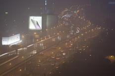 Cars drive on a highway on a hazy night in downtown Shanghai January 25, 2015. REUTERS/Aly Song