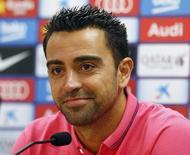 Capitão do Barcelona, Xavi, em entrevista coletiva. 22/08/2014 REUTERS/Gustau Nacarino