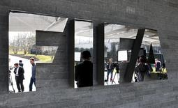 Journalists are reflected in the FIFA logo in Zurich March 20, 2015. REUTERS/Arnd Wiegmann