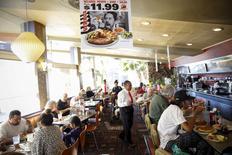 Customers dine at Norms Diner on La Cienega Boulevard in Los Angeles, California May 20, 2015. REUTERS/Patrick T. Fallon