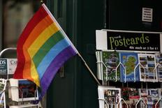 A Gay Pride flag displayed in a shop window in central Dublin in Ireland May 21, 2015. REUTERS/Cathal McNaughton