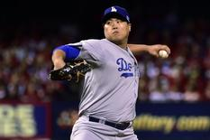 Los Angeles Dodgers starting pitcher Hyun-Jin Ryu (99) pitches during the first inning against the St. Louis Cardinals in game three of the 2014 NLDS baseball playoff game at Busch Stadium; Oct 6, 2014; St. Louis, MO, USA; Scott Rovak-USA TODAY Sports