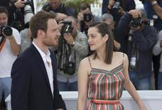 """Cast members Marion Cotillard (R) and Michael Fassbender pose during a photocall for the film """"Macbeth"""" in competition at the 68th Cannes Film Festival in Cannes, southern France, May 23, 2015.         REUTERS/Yves Herman"""