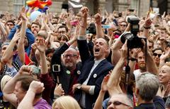 People react as Ireland voted in favour of allowing same-sex marriage in a historic referendum, in Dublin May 23, 2015. REUTERS/Cathal McNaughton