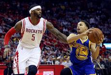 May 23, 2015; Houston, TX, USA; Golden State Warriors guard Stephen Curry (30) looks to shoot as Houston Rockets forward Josh Smith (5) defends during the game in game three of the Western Conference Finals of the NBA Playoffs at Toyota Center. Troy Taormina-USA TODAY Sports