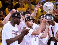 May 27, 2015; Oakland, CA, USA; (Editor's Note: Caption Correction) Golden State Warriors guard Stephen Curry (30) celebrates with the western conference championship trophy after defeating the Houston Rockets in game five of the Western Conference Finals of the NBA Playoffs at Oracle Arena. Kyle Terada-USA TODAY Sports