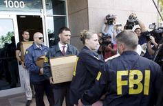 FBI agents bring out boxes after an operation inside the CONCACAF (Confederation of North, Central America and Caribbean Association Football) offices in Miami Beach, Florida May 27, 2015. REUTERS/Javier Galeano