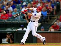 May 29, 2015; Arlington, TX, USA; Texas Rangers left fielder Josh Hamilton (32) hits his second home run of the game during the fourth inning against the Boston Red Sox at Globe Life Park in Arlington. Kevin Jairaj-USA TODAY Sports