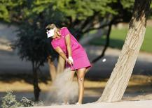 Anna Nordqvist of Sweden takes a shot on the 14th hole during the third round of the Dubai Ladies Masters December 12, 2014. REUTERS/Caren Firouz