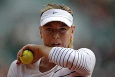 Maria Sharapova of Russia wipes her face during her women's singles match against Lucie Safarova of the Czech Republic during the French Open tennis tournament at the Roland Garros stadium in Paris, France, June 1, 2015. REUTERS/Gonzalo Fuentes