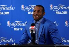 Jun 4, 2015; Oakland, CA, USA; Golden State Warriors guard Andre Iguodala (9) speaks the media after beating the Cleveland Cavaliers in game one of the NBA Finals at Oracle Arena. Mandatory Credit: Kyle Terada-USA TODAY Sports