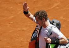 Andy Murray of Britain leaves the court after being defeated by Novak Djokovic of Serbia during their men's semi-final match at the French Open tennis tournament at the Roland Garros stadium in Paris, France, June 6, 2015. REUTERS/Jean-Paul Pelissier