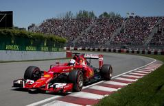 Ferrari Formula One driver Sebastian Vettel of Germany drives his car during the qualifying session of the Canadian F1 Grand Prix at the Circuit Gilles Villeneuve in Montreal June 6, 2015. REUTERS/Christinne Muschi