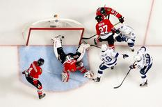 Tampa Bay Lightning left wing Ondrej Palat (18) scores a goal past Chicago Blackhawks goalie Corey Crawford (50) in the third period in game three of the 2015 Stanley Cup Final at United Center on Jun 8, 2015. Dennis Wierzbicki-USA TODAY Sports