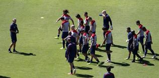 U.S. national soccer team coach Juergen Klinsmann (L) directs a training session ahead of their 2014 World Cup round of 16 match against Belgium in Salvador, June 30, 2014.  REUTERS/Marcos Brindicci