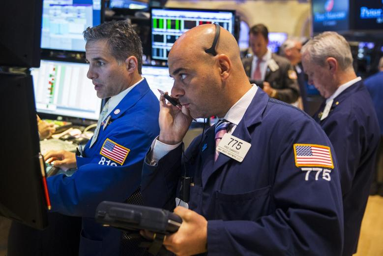 Traders work on the floor of the New York Stock Exchange shortly after the opening bell June 2, 2015. REUTERS/Lucas Jackson