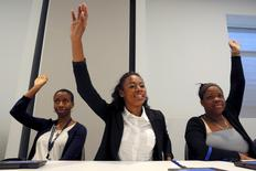 High school students from the City on a Hill Charter Public School, including Tacra McNeil Davi (C), playing the role of U.S. senators, cast a vote at the Edward M. Kennedy Institute in Boston, Massachusetts June 10, 2015. REUTERS/Brian Snyder