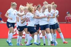 Jun 11, 2015; Ottawa, Ontario, CAN; Norway midfielder Maren Mjelde (6) is congratulated by teammates after scoring a goal against Germany on a free kick in the second half of a Group B soccer match in the 2015 FIFA women's World Cup at Lansdowne Stadium. Marc DesRosiers-USA TODAY Sports