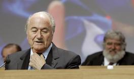 A file picture shows FIFA President Sepp Blatter (L) standing in front of executive member Chuck Blazer of the U.S. during the 61st FIFA congress at the Hallenstadion in Zurich June 1, 2011. REUTERS/Arnd Wiegmann