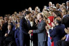 Liberal leader Justin Trudeau shakes hands with Liberal candidates after making a policy announcement during an event in Ottawa, Canada, June 16, 2015. REUTERS/Chris Wattie