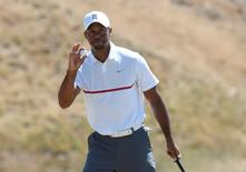 Jun 19, 2015; University Place, WA, USA; Tiger Woods waves to the crowd after putting on the 1st hole in the second round of the 2015 U.S. Open golf tournament at Chambers Bay. Mandatory Credit: Michael Madrid-USA TODAY Sports