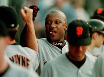 San Francisco Giants' Darryl Hamilton is congratulated by teammate Brent Mayne (L), after scoring from third base on Barry Bonds ground ball out against the Anaheim Angels in the first inning of their interleague game in Anaheim, California in a July 1, 1998 file photo. REUTERS/stringer/files