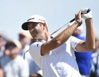 Jun 21, 2015; University Place, WA, USA; Dustin Johnson hits his tee shot on the 3rd hole in the final round of the 2015 U.S. Open golf tournament at Chambers Bay. Mandatory Credit: Michael Madrid-USA TODAY Sports