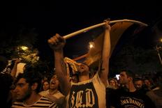 Protesters shout slogans during a rally against a recent decision to raise public electricity prices in Yerevan, Armenia, June 23, 2015. Thousands of Armenians staged a second day of protests on Tuesday in the capital Yerevan against a hike in electricity prices, defying police who used water cannon to try to disperse them. Armenians are angry over a decision by the state regulatory commission last week to increase the electricity tariff by up to 22 percent from August 1. Picture taken June 23, 2015. REUTERS/Hrant Khachatryan/PAN Photo ATTENTION EDITORS - THIS IMAGE HAS BEEN SUPPLIED BY A THIRD PARTY. IT IS DISTRIBUTED, EXACTLY AS RECEIVED BY REUTERS, AS A SERVICE TO CLIENTS - RTR4YQ4H