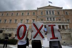 """Protesters hold placards forming the word """"No"""" during an anti-EU protest outside the parliament in Athens, Greece June 28, 2015.  REUTERS/Yannis Behrakis"""