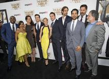 Director of the movie Gregory Jacobs (R), writer of the movie Reid Carolin (4th from R) pose with cast members (from -R) Stephen Boss, Jada Pinkett Smith, Andie MacDowell, Matt Bomer, Elizabeth Banks, Chnning Tatum, Adam Rodriguez and Joe Manganiello. REUTERS/Mario Anzuoni