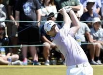 Jun 21, 2015; University Place, WA, USA; Branden Grace hits his tee shot on the 1st hole in the final round of the 2015 U.S. Open golf tournament at Chambers Bay. Mandatory Credit: Michael Madrid-USA TODAY Sports