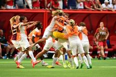 England midfielder Jill Scott (8) celebrates with teammates after defeating Canada in the quarterfinals of the FIFA 2015 Women's World Cup at BC Place Stadium. England won 2-1. Mandatory Credit: Anne-Marie Sorvin-USA TODAY Sports