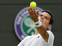 Milos Raonic of Canada serves during his match against Tommy Haas of Germany at the Wimbledon Tennis Championships in London, July 1, 2015.       REUTERS/Suzanne Plunkett