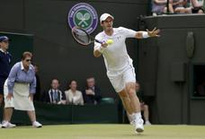 Andy Murray of Britain hits a shot during his match against Robin Haase of the Netherlands at the Wimbledon Tennis Championships in London, July 2, 2015.          REUTERS/Henry Browne