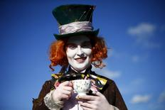 Ella poses as the Mad Hatter from Alice in Wonderland, outside the MCM Comic Con at the Excel Centre in East London, Britain, in this October 25, 2014 file photo. ARTS-ALICE/ REUTERS/Andrew Winning/Files