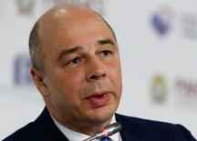 """Russia's Finance Minister Anton Siluanov speaks as he attends the Gaidar Forum 2015 """"Russia and the World: New Dimensions"""" in Moscow, January 14, 2015. Russia must cut expenditure to cover what could be a more than $45 billion drop in revenues this year if the average oil price is $50 a barrel, Finance Minister Anton Siluanov said on Wednesday. REUTERS/Sergei Karpukhin (RUSSIA - Tags: BUSINESS HEADSHOT) - RTR4LD4S"""
