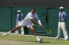 Nick Kyrgios of Australia hits a shot during his match against Milos Raonic of Canada at the Wimbledon Tennis Championships in London, July 3, 2015.  REUTERS/Stefan Wermuth
