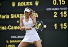 Maria Sharapova of Russia hits a shot during her match against Irina-Camelia Begu of Romania at the Wimbledon Tennis Championships in London, July 3, 2015.             REUTERS/Toby Melville