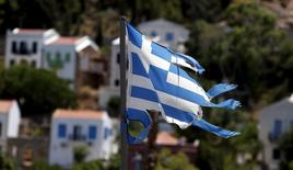 A tattered Greek flag flutters in the village of Meyisti on the Island of Kastellorizo which is the most easterly of the islands in Greece, July 4, 2015. REUTERS/Cathal McNaughton