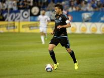 New York City FC forward David Villa (7) plays the ball during the second half against the Montreal Impact at Stade Saputo. Eric Bolte-USA TODAY Sports