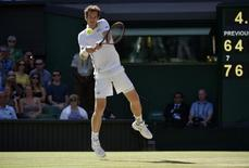 Andy Murray of Britain hits the ball during his match against Ivo Karlovic of Croatia at the Wimbledon Tennis Championships in London, July 6, 2015. REUTERS/Toby Melville