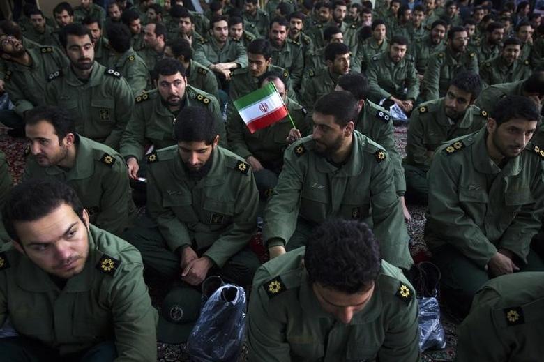 Members of the revolutionary guard attend the anniversary ceremony of Iran's Islamic Revolution at the Khomeini shrine in the Behesht Zahra cemetery, south of Tehran, February 1, 2012. REUTERS/Raheb Homavandi