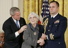 Former U.S. President George W. Bush (L) awards the Presidential Medal of Freedom to American novelist Harper Lee (C) in the East Room of the White House, November 5, 2007. REUTERS/Larry Downing/Files