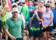 Jul 12, 2015; Silvis, IL, USA; Jordan Spieth is watched by fans as he walks to the eleventh hole in the Final Round at the John Deere Classic at TPC Deere Run.  Jeffrey Becker-USA TODAY Sports