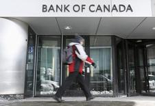 A man walks past the Bank of Canada office in Ottawa March 4, 2015.  REUTERS/Chris Wattie