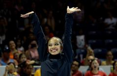 Jul 19, 2015; Toronto, Ontario, CAN; Laura Zeng of the United States celebrates winning the gold medal in the rhythmic gymnastics ball final during during the 2015 Pan Am Games at Toronto Coliseum. Mandatory Credit: Eric Bolte-USA TODAY Sports