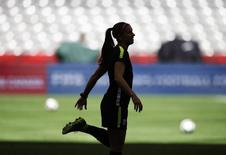 United States forward Alex Morgan stretches during a training session for the 2015 Women's World Cup at B.C. Place. Mandatory Credit: Michael Chow-USA TODAY Sports